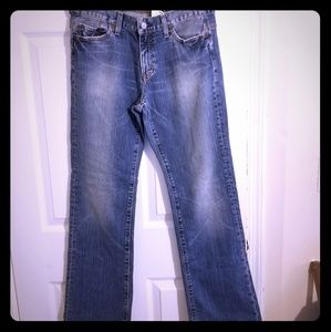 Gap Low Rise Boot Cut Distressed Jeans.